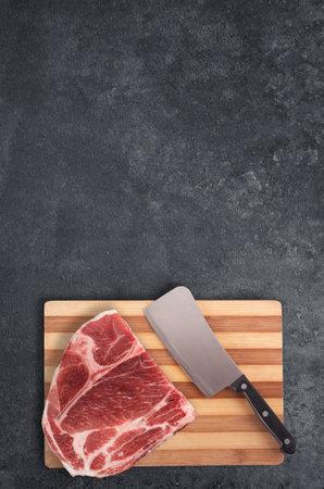raw beef steak on dark background Standard-Bild