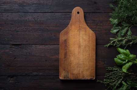 Fresh spices thyme, cardamom, basil, mint, parsley, dill and rosemary on wooden background. Standard-Bild