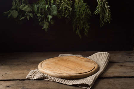 Wooden tray and various herbs.