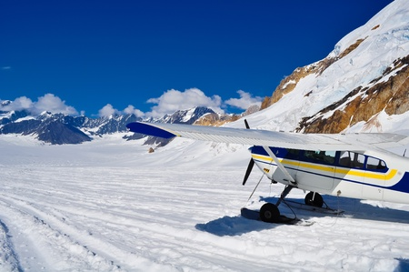 Small plane landed on a glacier near mount Denali, Alaska