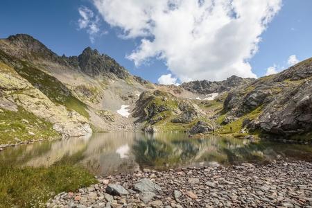 Russia. Sochi. Krasnaya Polyana. Territory of Caucasus Biosphere Reserve. The lake Sineokoye (Blue-eyed )against mountains. Stock Photo
