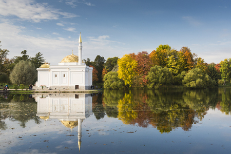 catherine: Saint Petersburg. Pushkin. Catherine park. View of Turkish Bath pavilion and the autumn trees which are reflecting in a pond. Editorial