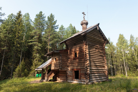 blessed trinity: Russia, Arkhangelsk. Museum of wooden architecture Malye Korely. Chapel for the sake of the Blessed Trinity, the beginning of the 18th century. July 25, 2016.