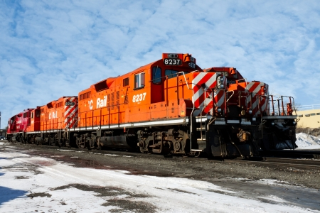 goods train: Group of four heavy diesel north american locomotive in winter against a cloudy sky