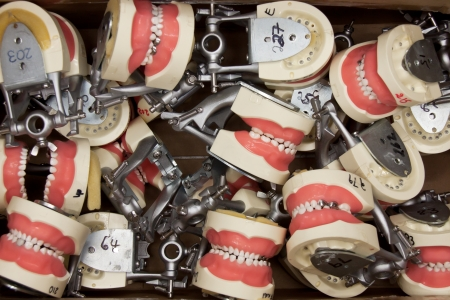 prothesis: A lot of dental prothesis in occlusion in a box
