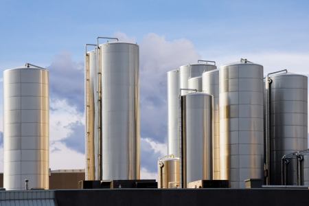 lite: 14 industrial metal tanks shine in the warm lite of the sunset
