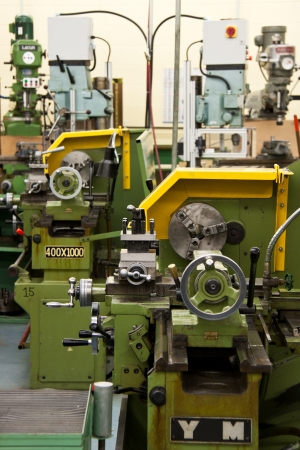 machines: Industrial enviroment with two work stations with lathes and a lot of other machines in background