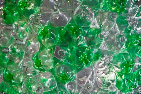Green and transparent plastic pet, putted together with screws like a background Stock Photo