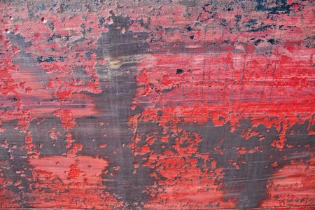 Grunge background with scratches rust and red paint everything on a plate of metal, part of a ship board photo