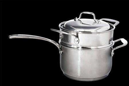 Steam shiny metal saucepan complex isolated in black