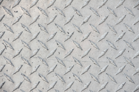 Industrial design pattern on a metal plate Stock Photo