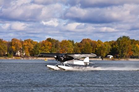 Take-off hydroplane in a fall landscape