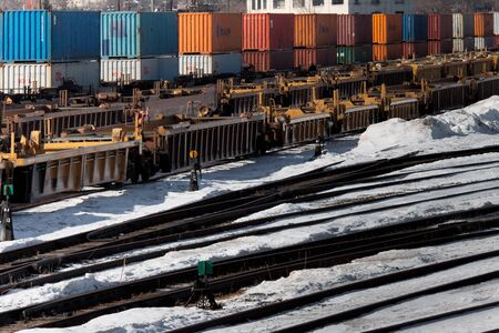 Industrial railway terminal in winter with container carrier wagons, rails and switchs Stock Photo - 20552176
