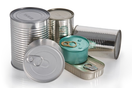 Six different shape and colors cans isolated in white