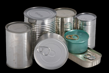 Seven different shape and colors cans isolated in black