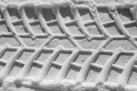 Tire tracks pattern prints in the snow photo