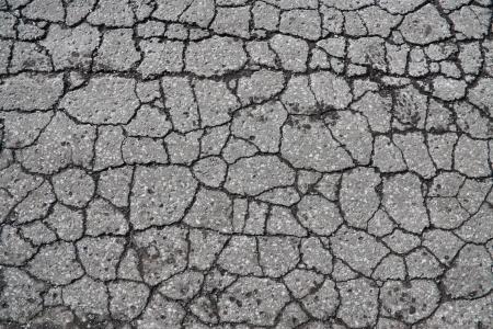 Cracked asphalt texture background Stock Photo