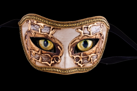 A beautiful venetian mask with music theme and cat eyes isolated in black