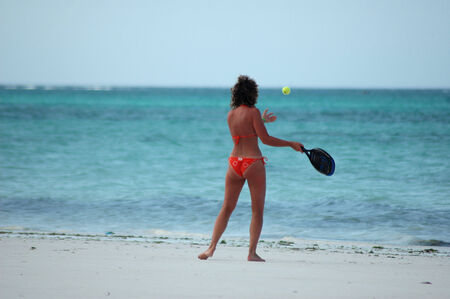 sexy girl playing beach tennis in tanzania