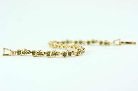 personal ornaments: Bracelet jewelry on white background ,Bracelet green sapphire Stock Photo