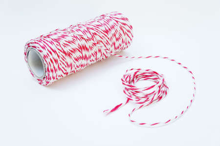 Red and white rope, tied tie multipurpose items seized or sticky material.