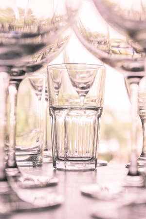 white wine: water glass on the shelves , Drinking water container, Empty water glass