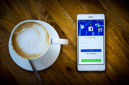 facebook social media network on smart phone and coffee time