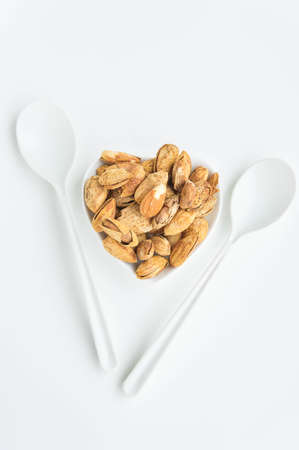 nutshells: Almond nuts to stay healthy for the body. almond on white background Stock Photo