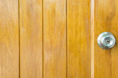 lockout: door knob wood backgrond , basic wood door