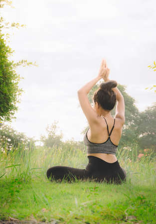 woman practicing  yoga day relax in nature Yoga Exercise Helps the mind to concentrate, calm and shape and healthy.
