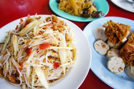 papaya salad , som tum food popular with Thai people.