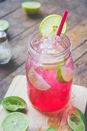 Red Lime Soda Soda beverage A mixture of Red nectar, salt, lemon and soda mixed together to refresh and quench thirst. Stock Photo