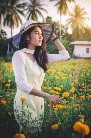 Woman in summer flowers garden , summer nature flowers time , summer trevel