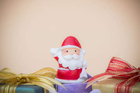 Santa Claus doll Christmas background and gift box and copy space