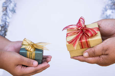 giving gift box in with hands On special days  for special person and copy space background Stock Photo
