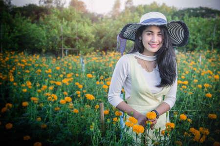 Woman in summer flower garden , travel on summer