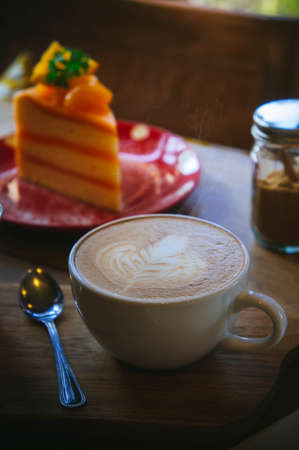 coffee cup and tasty cake on wood table and Blank paper waiting for ideas , coffee time work Stock Photo