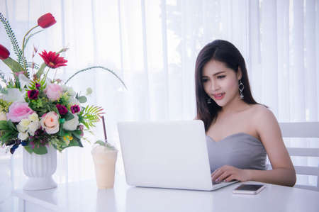 Smart girls working on notebook , Workingwoman using laptop in the room Stok Fotoğraf