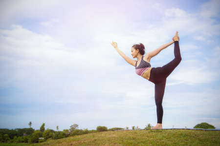yoga girl In the morning time on blue sky background Strengthen the concentration of skin, health and good health is a good exercise