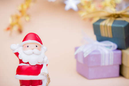 santa claus doll christmas background and gift box Stok Fotoğraf