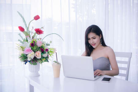 Woman using laptop in the room