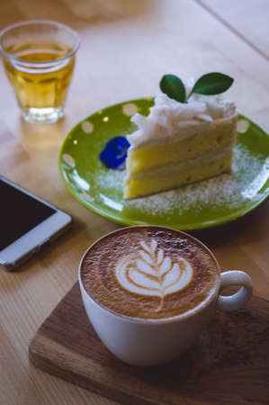 coffee time and cake on wood table in cafe relax on the coffee break