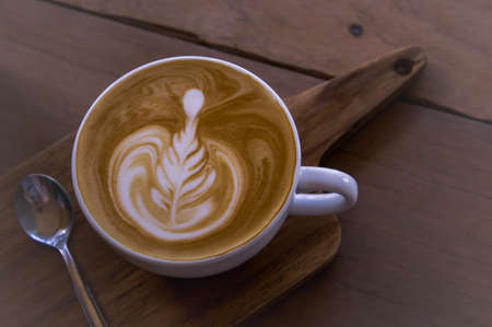 coffee latte art on wood table , coffee for idea Stock Photo