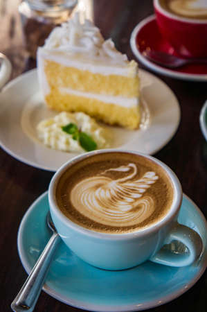 coffee time in the wood table cafe , drink coffee and tasty cake