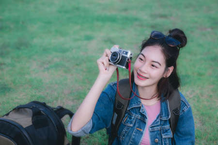 traveler girls sitting take a photo and smile looking the nature around Stock Photo