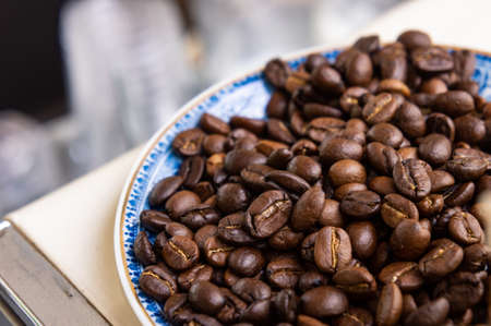 coffee beans on dish in cafe restaurant