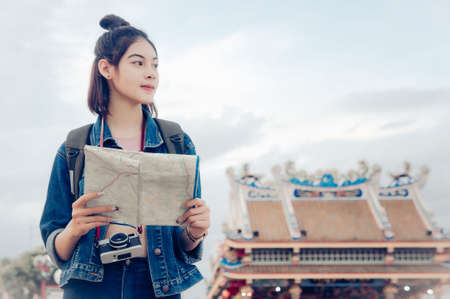 tourist girls hold a map and looking at view Travel location Cultural and smiling  on the day trip