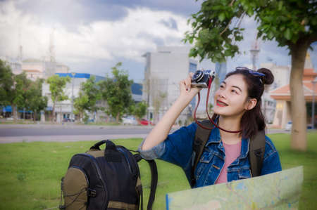 girls take a photo in the park on the nice day , happy to travel
