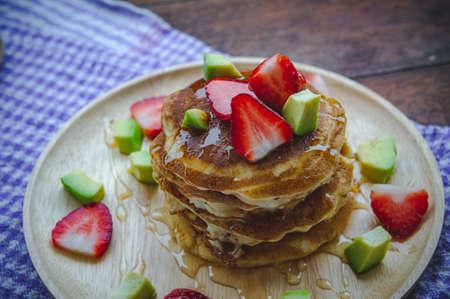 pancake strawberry avocado fruit and honey syrup sweet dessert on wood table pan cake dessert homemade