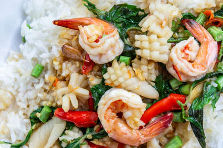 Fried basil shrimp with squid topped with rice